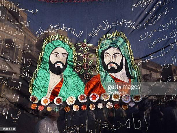 Portraits of Imam Hussein and Imam Ali cousins of the prophet Mohammed are shown near Kadhimain Shrine as Shiites are celebrate a religious festival...