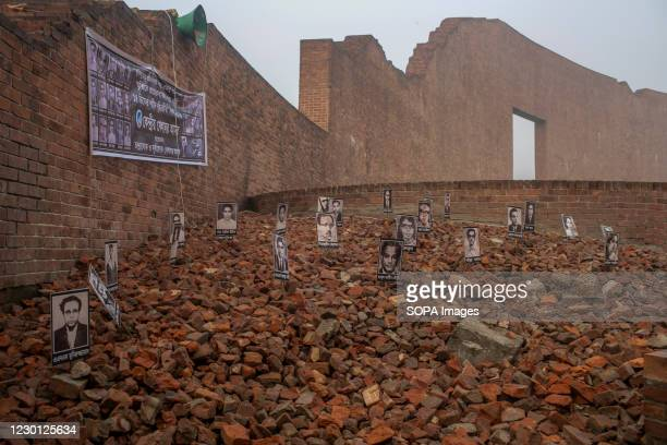 Portraits of intellectuals who were killed on 14th December are seen in front of the martyred intellectual memorial in Dhaka. Thousands of...