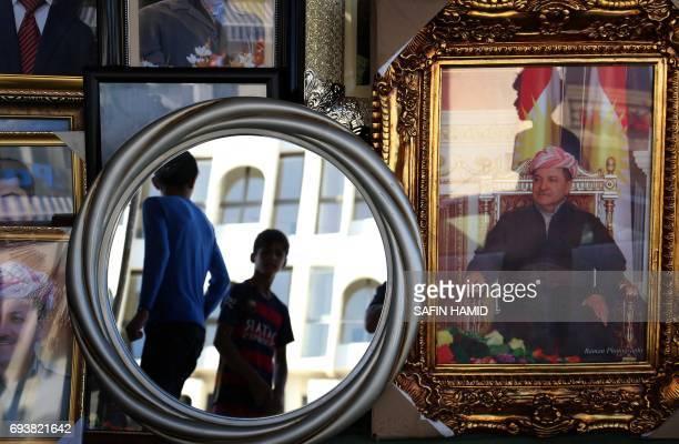 Portraits of Iraqi Kurdish leader Massud Barzani are seen hanging in a store in Arbil the capital of the autonomous Kurdish region of northern Iraq...