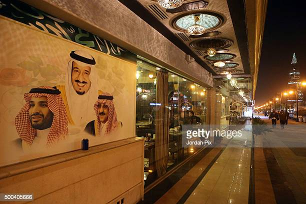 Portraits of King Salman Bin Abdulaziz Crown Prince Muhammad Bin Nayef and Deputy Crown Prince Mohammad Bin Salman Al Saud are displayed on the wall...