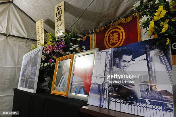 Portraits of late actor Bunta Sugawara are displayed during the 'Dekotora' decoration trucks gathering event in commemoration for the actor at Tone...