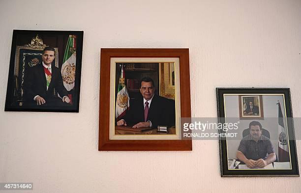 Portraits of Mexican President Enrique Pena Nieto the Governor of Guerrero Angel Aguirre and the Mayor of Cocula Cesar Miguel Penaloza Santana hang...