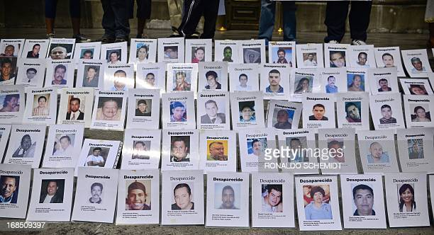 Portraits of missing people are displayed in Mexico City on May 10 2013 A group of mothers and relatives are demanding that the government...
