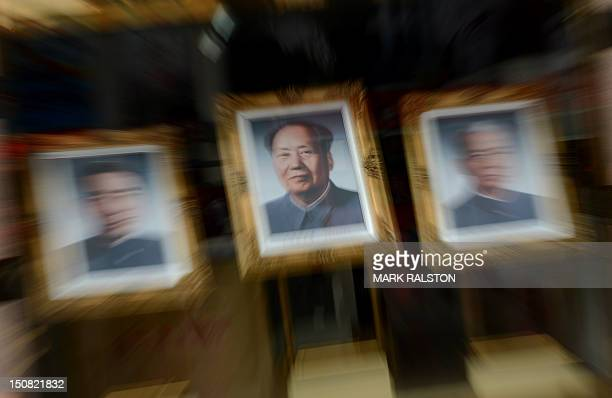 Portraits of past leaders including Zhou Enlai , Mao Zedong and Liu Shao Qi hang in a shop as the city prepares for the upcoming 18th National...