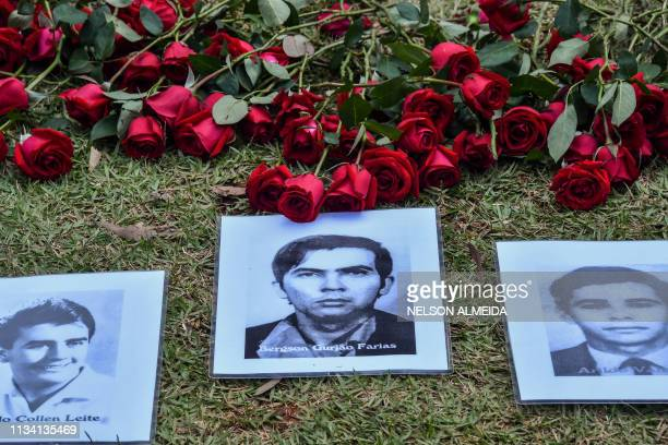 Portraits of persons who were killed or went missing during the 19641985 dictatorship are displayed during a demonstration on the 55th anniversary of...