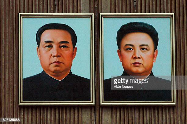 Portraits of President Kim Il Sung and his son Kim Jong Il, current Secretary General of the Korean Workers Party and Chief General of the army, in...