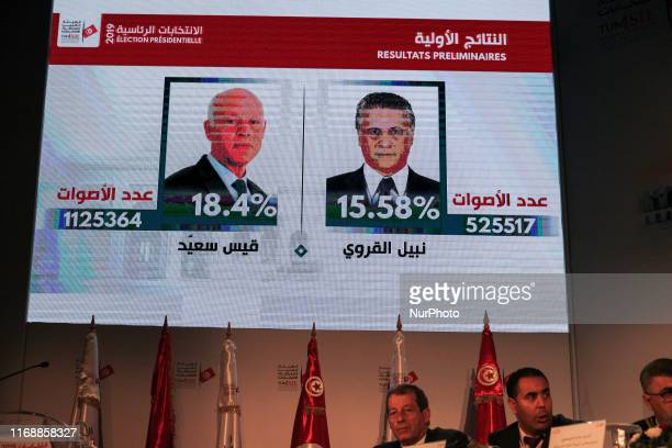 Portraits of presidential candidates Kais Saied and Nabil Karoui screened during a press conference held by the Independent High Authority for...