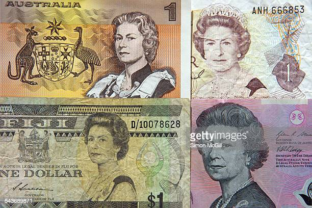 Portraits of Queen Elizabeth II on old one dollar paper banknotes of Australia New Zealand and Fiji and on the current five dollar polymer banknote...