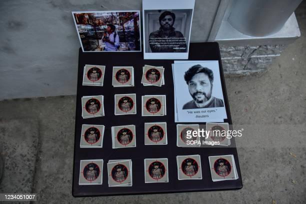 Portraits of slain Reuters journalist Danish Siddiqui, lie on the table during a candle light vigil at Kashmir Press Club in Srinagar. Danish...