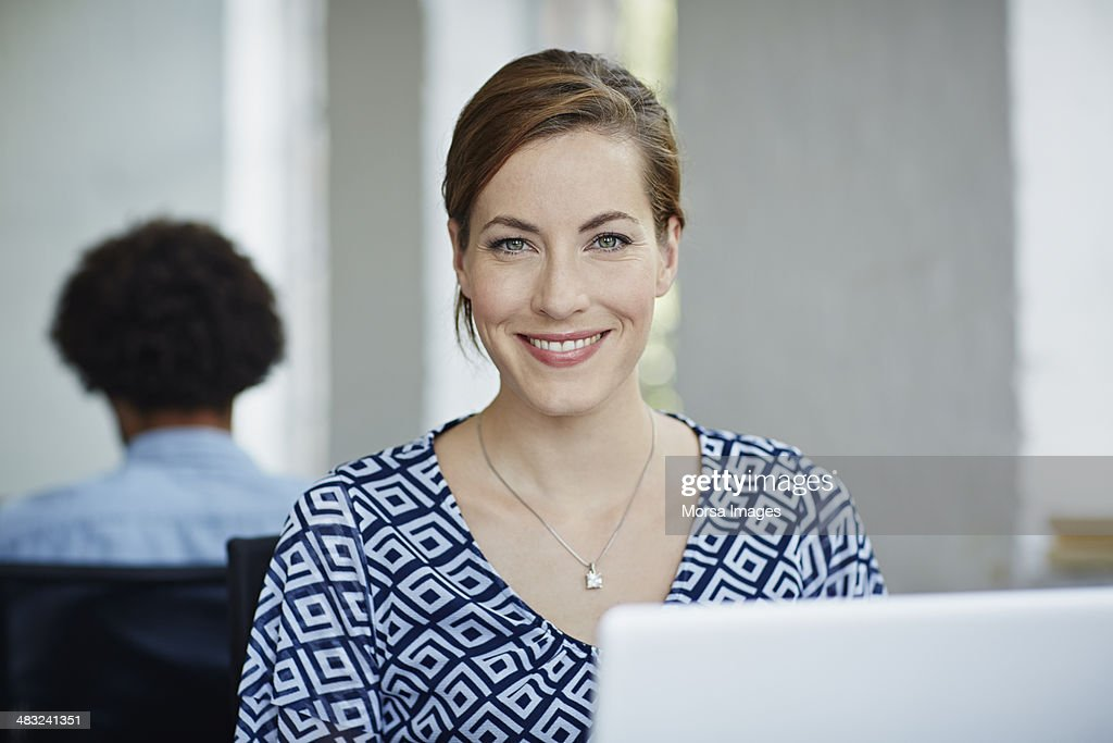 Portraits of smiling business woman : Stock Photo