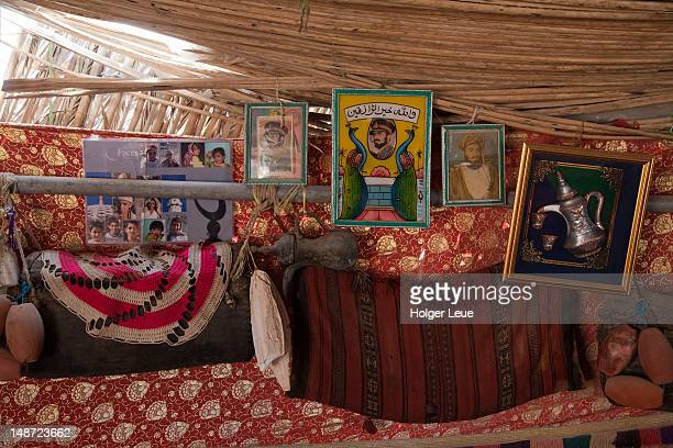 portraits of sultan qaboos of oman inside bedouin family home. - qaboos bin said al said stock pictures, royalty-free photos & images