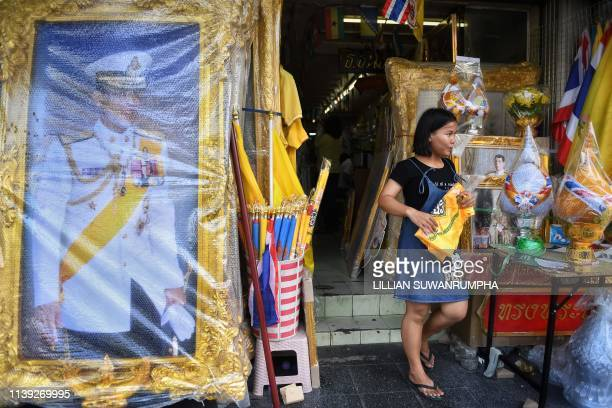 Portraits of Thailand's King Maha Vajiralongkorn are displayed for sale in Bangkok on April 25 ahead of his royal coronation