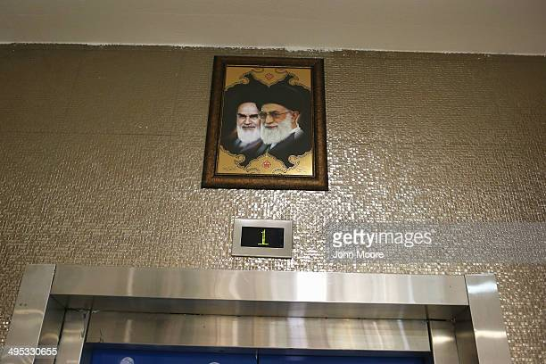 Portraits of the late Ayatollah Khomeini and Iran's current supreme leader Ayatollah Khamenei gaze hang over an elevator in the new Isfahan City...