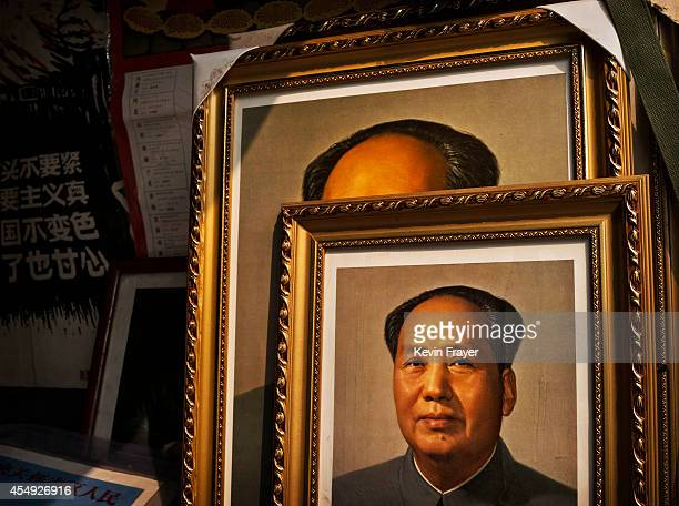 Portraits of the late Chinese leader Mao Zedong are seen for sale at a vendor's stand at a market on September 7 2014 in Beijing China Chairman Mao a...