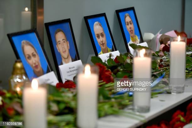 Portraits of the victims of the Ukraine International Airlines Boeing 737800 crash in the Iranian capital Tehran are seen at a memorial at the...