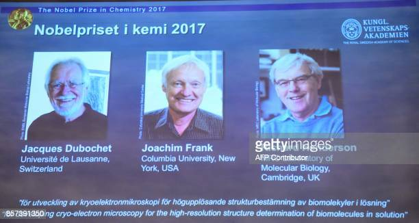 Portraits of the winners of the 2017 Nobel Prize in Chemistry are seen on a screen Jacques Dubochet from Switzerland Joachim Frank from the US and...