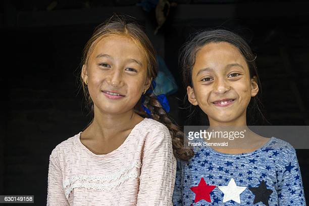 Portraits of two smiling girls in Upper Marsyangdi valley