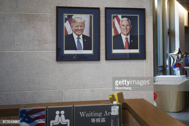 Portraits of US President Donald Trump and US Vice President Mike Pence are displayed inside the American Institute in Taiwan's new complex in Taipei...