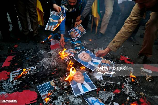 Portraits of US President Donald Trump burn during a demonstration in the capital Tehran on December 11 2017 to denounce his declaration of Jerusalem...