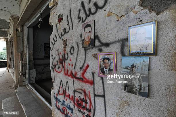 Portraits of victims mark the memorial to the Islamic State massacre of 1700 Shiite Air Force cadets from Camp Speicher beneath a bridge where...
