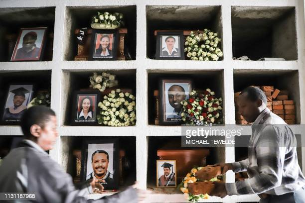 Portraits of victims of the crashed accident of Ethiopian Airlines are displayed during the mass funeral at Holy Trinity Cathedral in Addis Ababa...