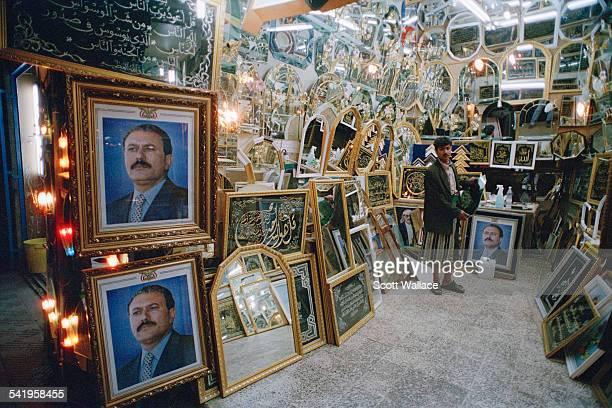 Portraits of Yemeni President Ali Abdullah Saleh in a mirror shop in Sana'a Yemen 2004
