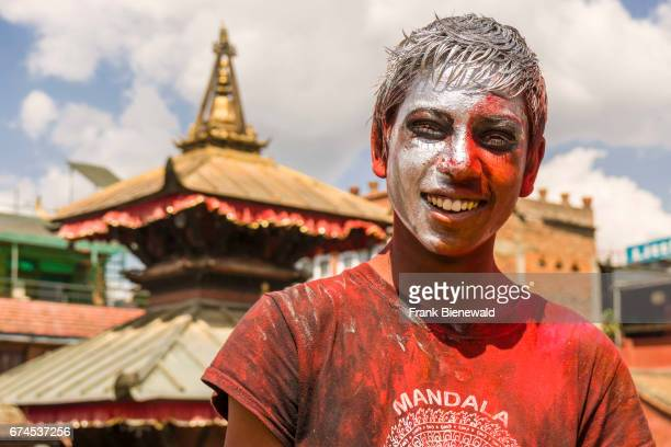 Portraits of young people smeared with color are celebrating the Holi Festival