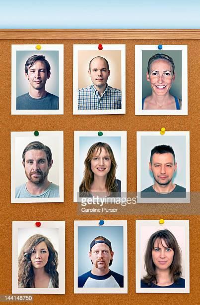 Portraits pinned to a corkboard