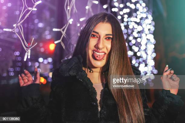 portraiture on woman at winter night - piercing stock photos and pictures