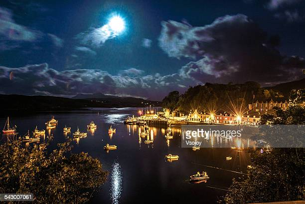 portree harbour sparkling at night - vsojoy stock pictures, royalty-free photos & images
