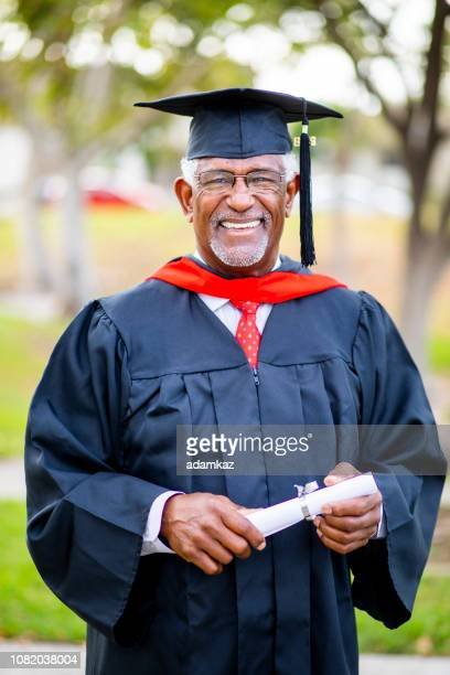 portriat of a senior black graduate - master's degree stock pictures, royalty-free photos & images