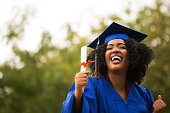 Portriat of a young African American Woman at graduation.