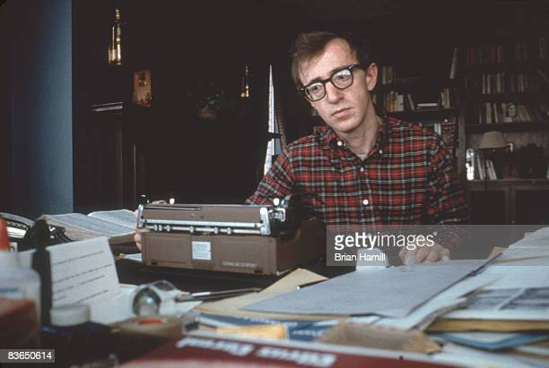 Portriat of American film director writer and actor Woody Allen as he writes on his typewriter at his home in New York New York 1976