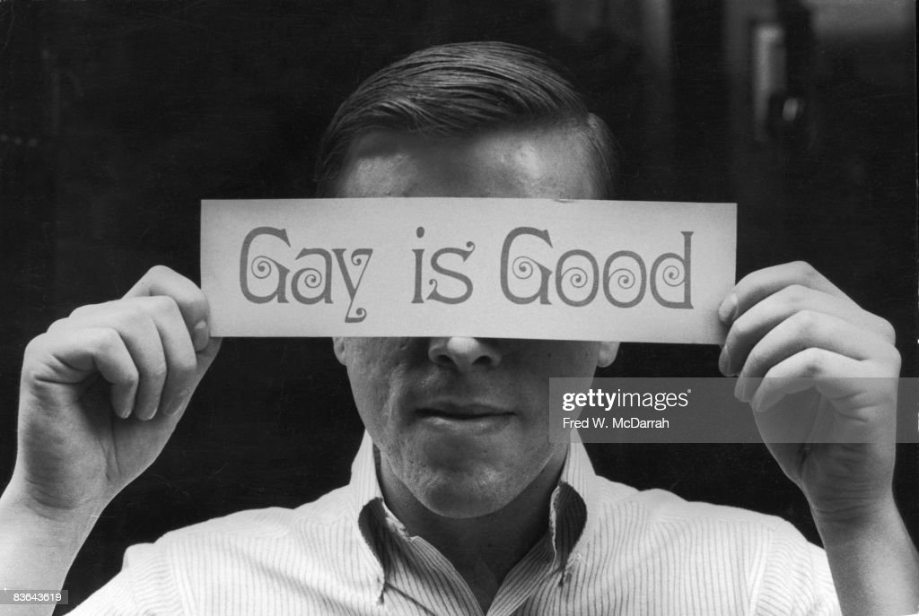 Portriat of American gay rights activist Craig Rodwell (1940 - 1993) as he holds a bumper-sticker sized sign that reads 'Gay is Good' over his eyes, New York, New York, October 14, 1969. Rodwell was the founder of the Oscar Wilde Memorial Bookstore, the first bookstore devoted exclusively to works by gay and lesbian authors.