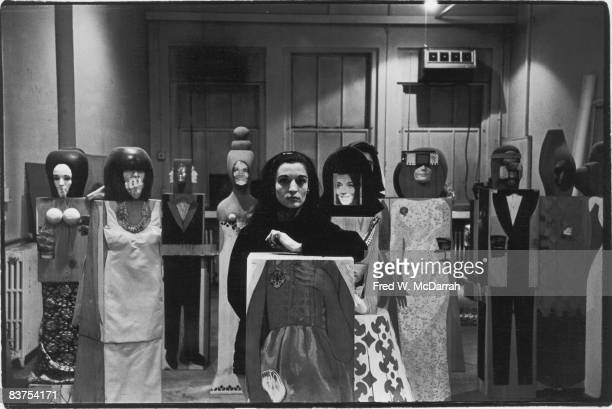 Portriat of French-born artist Marisol Escobar as she poses amid a group of her sculptures, New York, New York, April 14, 1966.