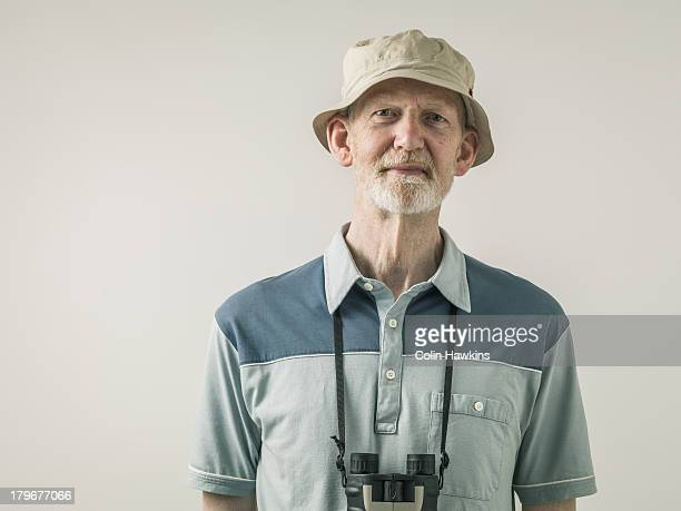 portrit of elderly man with binoculars - binoculars stock pictures, royalty-free photos & images
