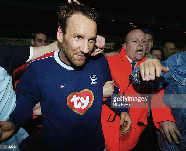 Portsmouth captain Paul Merson of Portsmouth celebrates his side winning promotion to the Premier League after the Nationwide League Division One...