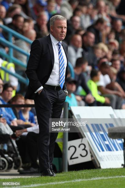 Portsmouth coach Kenny Jackett watches from the touchline during the Sky Bet League One match between Gillingham and Portsmouth at Priestfield...