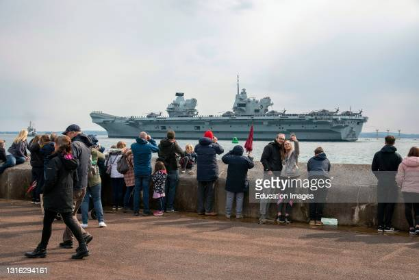 Portsmouth, England, UK. Well wishers watch as HMS Queen Elizabeth departs Portsmouth on her maiden deployment to the Pacific Ocean.