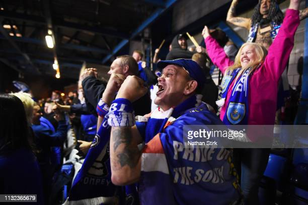 Portsmouth fan celebrates after they score the first goal of the game during the Checkatrade Trophy match between Bury and Portsmouth at Gigg Lane on...