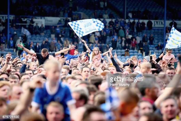 Portsmouth fan waves a promotion flag after the Sky Bet League Two match between Portsmouth and Cheltenham Town at Fratton Park on May 6 2017 in...