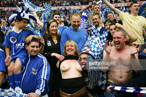 Portsmouth fans celebrate their victory after winning The FA Cup after beating Cardiff City in the final at Wembley Stadium in London on May 17 2008...