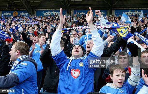 Portsmouth fans celebrate victory after the FA Cup sponsored by Eon quarter final match between Portsmouth and Birmingham City at Fratton Park on...