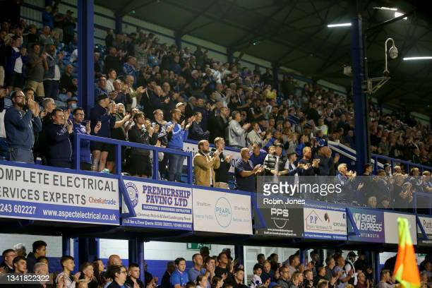 Portsmouth fans clap on the 10 minute mark in memory of Sophie Fairall, a young cancer sufferer who died earlier in the week, during the Sky Bet...