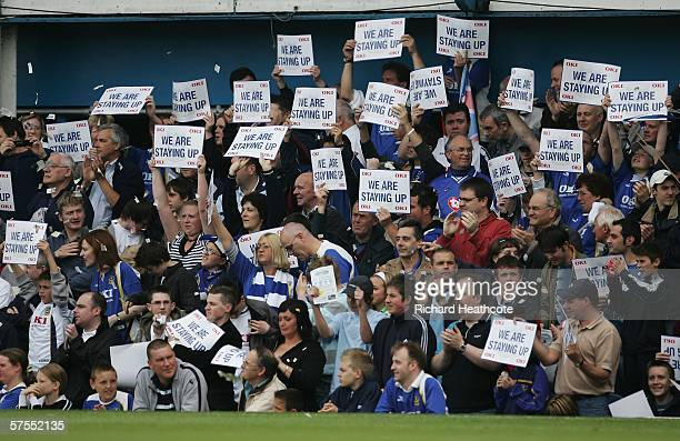 Portsmouth fans hold up signs after their team avoided relegation during the Barclays Premiership match between Portsmouth and Liverpool at Fratton...