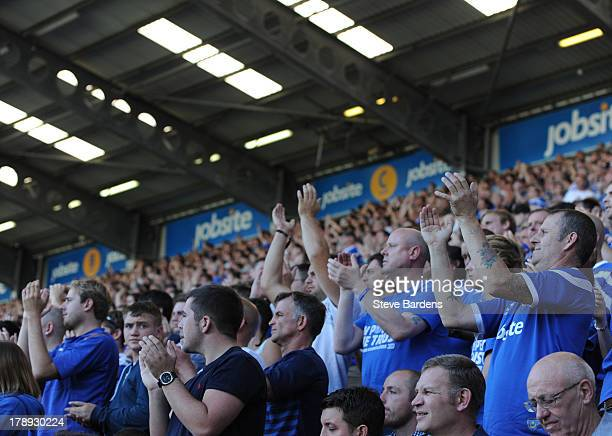 Portsmouth fans support their team during the Sky Bet League Two match between Portsmouth and Chesterfield at Fratton Park on August 31 2013 in...