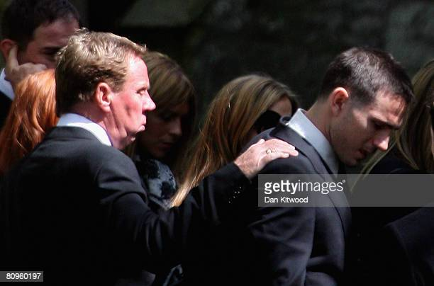 Portsmouth FC manager Harry Redknapp consoles his nephew Chelsea player Frank Lampard outside the church at the funeral of his mother Pat at St...