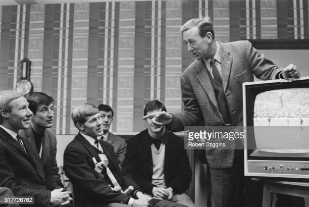Portsmouth FC's manager George Smith and his players watch a recording of a match against Birmingham City FC on a television UK 7th March 1968