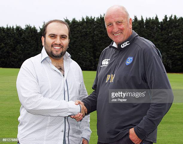 Portsmouth FC's new chairman Sulaiman Al Fahim shakes hands with the manager Paul Hart during a visit to the club's training ground on July 21 2009...