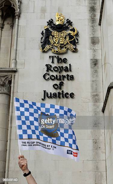 Portsmouth football club fan David Maples waves a club flag outside the High Court on February 10 2010 in London England Portsmouth FC have seven...